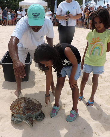 "The Reading Family escort their turtle ""Shelly"" to the sea"
